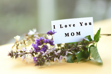 Flower bouquet with I love you mom text on card,Mother's day concept