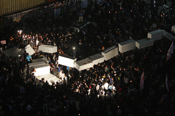 Protesters pile up large Styrofoam blocks in front of cargo containers that contain sand to form a barricade set by police to block protesters' march in central Seoul