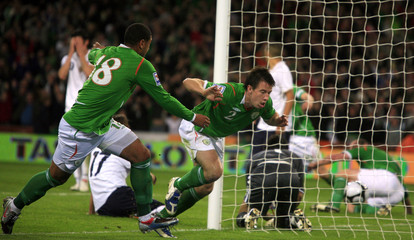 Ireland's St. Ledger celebrates after scoring against Italy during World Cup 2010 qualifying soccer match in Dublin