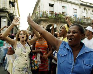 CUBANS CHEER DURING VIRGIN OF COBRE PROCESSION.