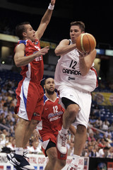 """Canada's Jesse Wade Young goes for the basket as Puerto Rico's Jose Juan Barea defends during their basketball game of the Genaro """"Tuto"""" Marchand Continental Cup in San Juan"""