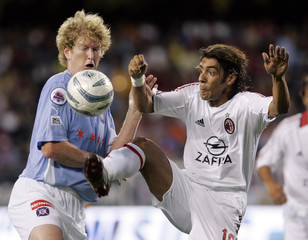 AC Milan's Costa and Chicago Fire's Curtin fight for control of the ball in Chicago, Illinois.