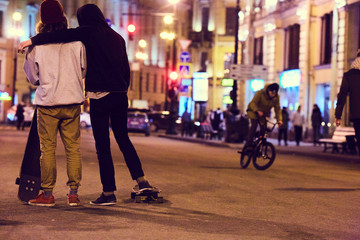 Skaters chilling on the night street of Saint Petersburg
