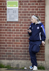 A woman smokes outside a job centre in Leicester
