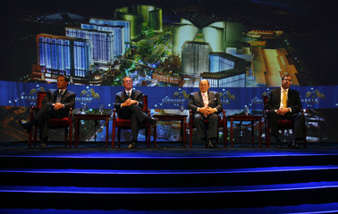 Top officials from the Las Vegas Sands Corporation attend a news conference in Macau