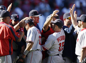 Boston Red Sox players, including pitcher Curt Schilling celebrate after defeating the Los Angeles Angels of Anaheim in Game 3 of their MLB American League Division Series playoff baseball game in Anaheim