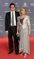 England's soccer manager Fabio Capello and a guest arrive for the Laureus Sports Awards in the Mariinsky Theatre in St Petersburg