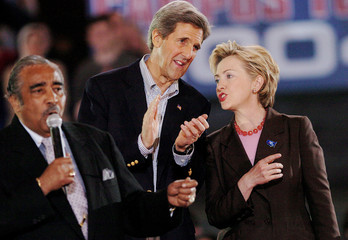 JOHN KERRY SPEAKS WITH HILLARY CLINTON AND CHARLES RANGEL IN NEW YORK.
