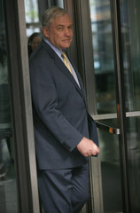 Conrad Black leaves at the Dirksen Federal courthouse in Chicago