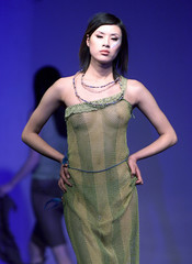 A CHINESE MODEL WEARS CLOTHES FROM A DOMESTIC CLOTHING COMPANY FOR THE 2001 CHINA INTERNATIONAL ...