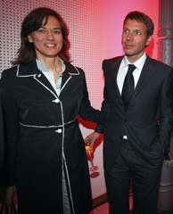 German TV host Illner and her fiance German Telekom CEO Obermann pose before a party after Bayern Munich defeated Borussia Dortmund in Berlin
