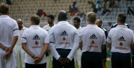 Indian and England cricket team players observe one minute silence for the victims of Mumbai militant attacks in Chennai