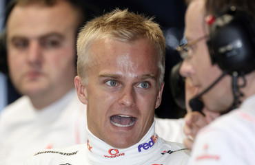McLaren Formula One driver Kovalainen of Finland speaks at pits before practice session for Singapore F1 Grand Prix