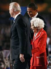 U.S. Vice President-elect Biden holds the hand of his mother Jean on stage in Chicago