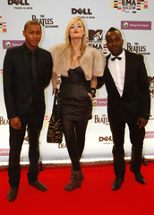 Rickie Haywood Williams, Laura Whitmore and Melvin Odoom pose on the red carpet before the MTV Europe Awards ceremony in Berlin