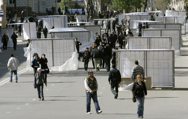 People walk past structures that opposition supporters say symbolise prison cells in Tbilisi