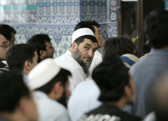 A Muslim man looks back over his shoulder during Friday prayers for the safe return of the kidnapped South Koreans in Afghanistan, at a mosque in Seoul
