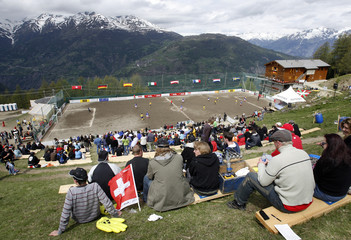 Players compete in Euro of Mountain Villages soccer tournament in Gspon in Swiss Alps