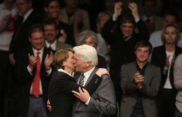 Steinmeier kisses his wife Elke Buedenbender after speech at party meeting in Berlin