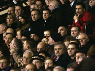 Fulham's manager Coleman sits in the stand during their English Premier League soccer match in Manchester