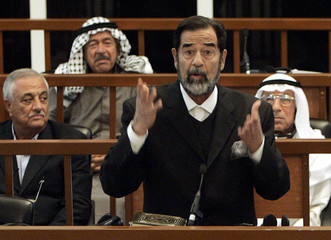 Former Iraqi President Saddam testifies during his trial on genocide charges at the fortified Green Zone in Baghdad