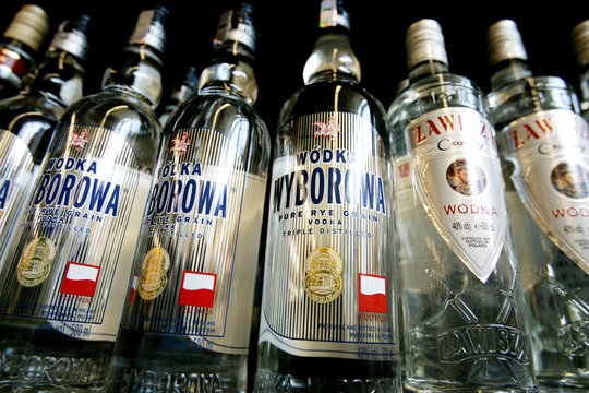 Bottles of Polish-made vodka called Wyborowa stand on a shelf at a liquor store in Warsaw.