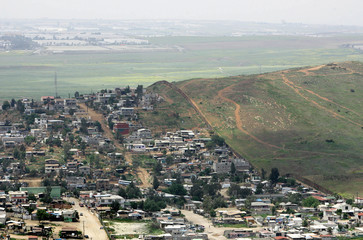 View of Mexican city of Tijuana is seen next to border between Mexico and United States