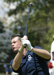 ENGLAND CRICKETER GILES TEES OFF DURING GOLF IN KINGSTON JAMAICA.