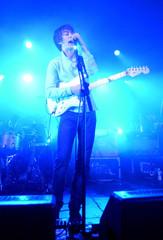 Singer Turner of British rock band Arctic Monkeys performs on stage during gig at Leeds University in Leeds northern England