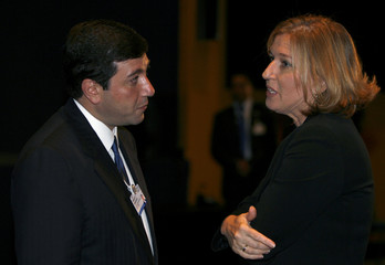 Israel's Foreign Minister Livni speaks to Jordanian Royal Court director Awadallah during the World Economic Forum (WEF) on the Middle East in Sharm el-Sheikh