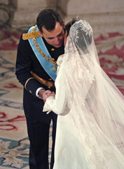 SPANISH CROWN PRINCE FELIPE RECEIVES KISS FROM BRIDE LETIZIA ORTIZ DURING WEDDING CEREMONY AT ...