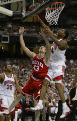 MARYLAND'S WILCOX SHOOTS OVER INDIANA'S ODLE.