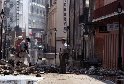 Rusk County County Sheriffs Department deputies survey damage on a French Quarter street in New Orleans.