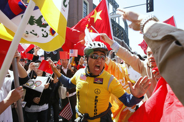 A pro-Tibet demonstrator stands with demonstrators and supporters during the Olympic Torch relay in San Francisco