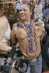 A woman bares her breasts for the crowd during Wingbowl 14 in Philadelphia