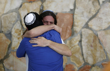 Relatives of Avraham Ozeri mourn during funeral in Jerusalem