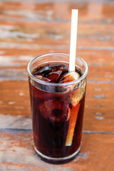 Cola in glass with ice cubes