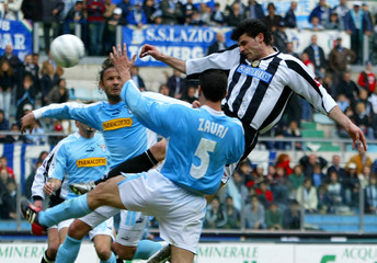 IAQUINTA OF UDINESE RISES ABOVE THE LAZIO'S DEFENCE TO SCORE IN THEIR SERIE A MATCH IN ROME.