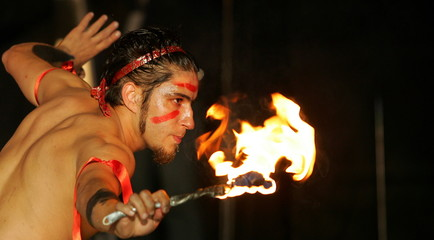 A circus artist performs with fire during the opening ceremony of Romania's  international music con..