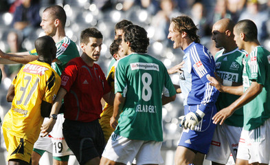 Referee Circhetta shows the red card to FC St.Gallen goalkeeper Razzetti during their Swiss Super League soccer match against YB