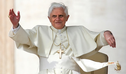 Pope Benedict XVI waves as he arrives to lead his weekly general audience in Saint Peter's Square