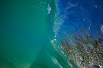 Ocean wave closing in barrel. View from inside with underwater part and a lip surface