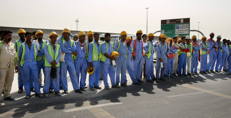 Workers are evacuated after part of a building under construction collapsed at Dubai airport killing at ...