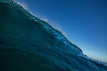 Barrel pipeline rip curl wave in ocean near shore