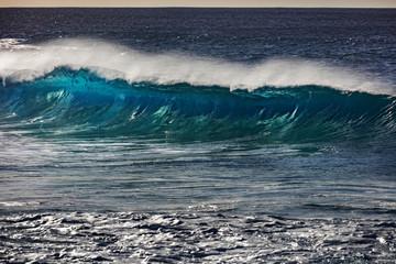 Surfing barrel ocean wave closing