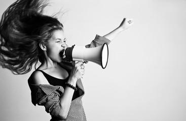 Young woman screaming in loudspeaker