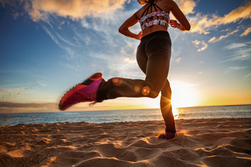 Healthy lifestyle sports woman running on sandy beach sunset seaside