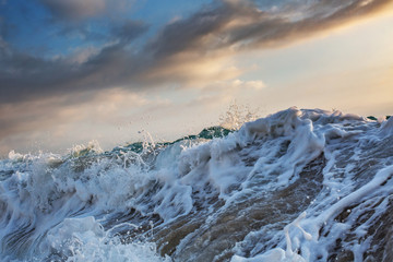 Rough ocean wave with white foam closeup shot