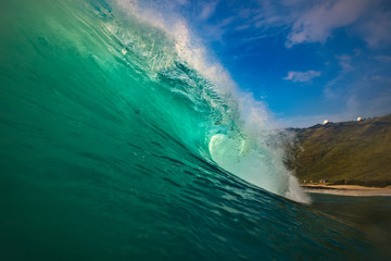 Hawaiian huge shorebreak wave. Ocean water for watersport activity. Surfing lessons at sunset time. Nobody on this picture