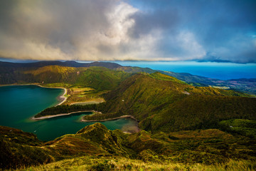 Green Mountain lake in Azores island. Beautiful airview of green valley with hills and beautiful clouds at sunset time